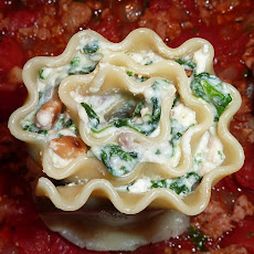 Lovely Lasagna Rolls Filled with Spinach and Goat and Ricotta Cheese Bechamel