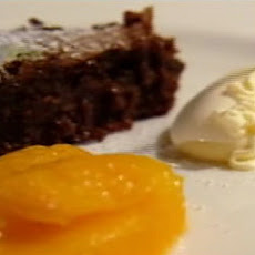 Dark chocolate and orange torte with orange segments poached in Grand Marnier syrup