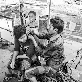Unsafe ear cleaning by Aktar Ratan - City,  Street & Park  Street Scenes