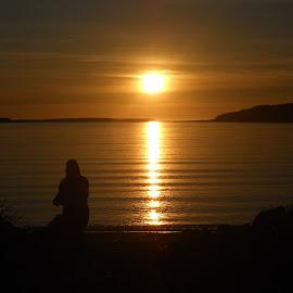 Woman by Ólafur Ingi Ólafsson - Landscapes Beaches ( iceland, sky, red, heaven, sunset, sea, cloud, beach, seascape, gold, sun )