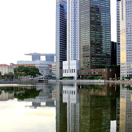 Of things to come by Leong Jeam Wong - Buildings & Architecture Office Buildings & Hotels ( office, calm, skyline, reflection, peaceful, image, hotel )