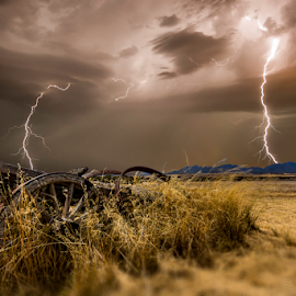 Incoming strikes over the farm by Craig Eccles - News & Events Weather & Storms ( thunder, lightning storm, wagon, storm, lightning strike., farm, field, mountains, lightning, lightning bolt, weather, thunder storm, thunder bolt )