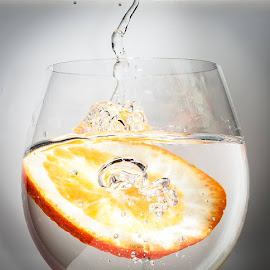 Orange in a glass by Velina Krasteva - Food & Drink Alcohol & Drinks ( water, orange, splash, drink, bubbles, glass, slice )