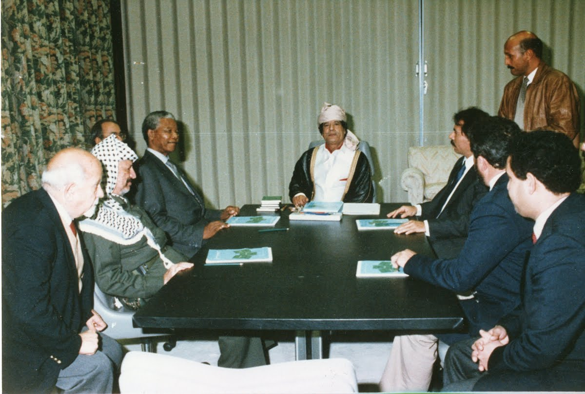 Nelson Mandela at a meeting with, amongst others, Colonel Muamar Gadaffi and Yasser Arafat.