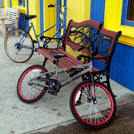 Small Town Trust by Jen Rhora - Transportation Bicycles ( small town, bicycles, bench, summer, storefront )