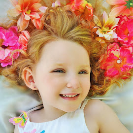I Love The Flowers In My Hair! by Cheryl Korotky - Babies & Children Child Portraits ( red hair, a heartbeat in time photography, flowers in hair, amazing faces, blue eyes, beautiful children, redhead, child model nevaeh, photo ideas for girls, portrait )