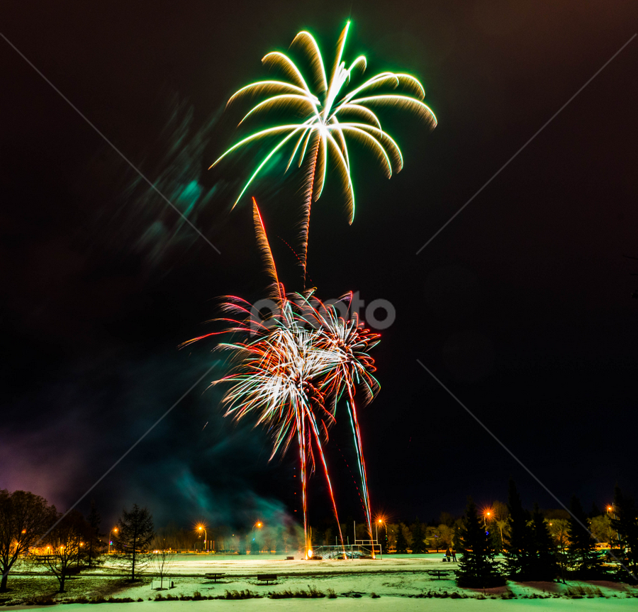 New  Year,s Eve Celebration by Joseph Law - Public Holidays New Year's Eve ( winter, cold, alberta, snow, sherwood park, fireworks, light poles, new year eve, street lights )