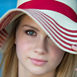 The Eyes have it by Carole Brown - People Portraits of Women ( blue wall, blonde hair, blue eyes, floppy hat )