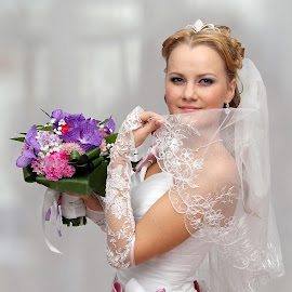 The bride with a bouquet of flowers by Feliks Kuchmakra - Wedding Bride ( body, bouquet, face, person, fashion, beauty, veil, people, triumph, looks, girl, style, hands, woman, smaile, flowers, bride, hair, clothes, white, portrait, holiday, dress, wedding, hairstyle, holds, bow )