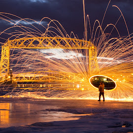 Winter Celebration by Jon Dyess - City,  Street & Park  Night ( duluth, lift bridge, spin, night, spark, fire )
