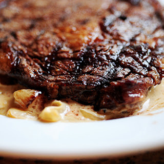 Grilled Ribeye Steak with Onion Blue Cheese Sauce