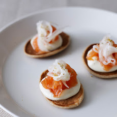 Cured Norwegian salmon with a shot of Linie aquavit, rye and sour cream pannekaker and pickled fennel