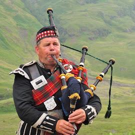 SCOTTISH PIPER by Wojtylak Maria - People Portraits of Men ( scotland, mountains, musician, piper, man )