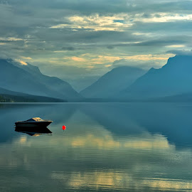 Morning Light at Lake McDonald by Jeff Clow - Landscapes Waterscapes ( reflection, waterscape, serenity, serene, lake, travel, landscape, boat, morning, glacier national park )