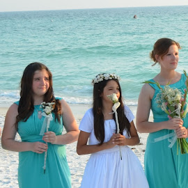 Beautiful Brides Maids all in a row with their beautiful Bride by Carmella Dunkin - Wedding Ceremony ( maid of honor, brides maids, floral bouquet, flower bouquet, flowers, beach wedding, floral, flower, bouquet )
