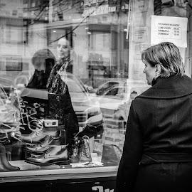 Window shopper by Adrian Mitu - City,  Street & Park  Street Scenes ( shop, b&w, window, woman, street, candid, shopping, on spot photowalks, photography )