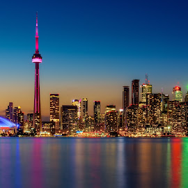Toronto Sunset Skyline by Nik Coli - City,  Street & Park  Skylines ( reflection, skyline, colorful, skyscrapers, toronto, fine art, nikcoli, cityscape, architecture, sun, dslr, city, wall art, nikon photography, cn tower, coli, nikcoliphotography, long exposure, license, nikon, water, cityscapes, end of the day, orange, canada, decoration, green, wallpaper, sea, canvas, relaxation, citylights, color photography, urban, rogers centre, dawn, color, blue, modern city, sunset, d7100, sundown, cityphotography, nik )