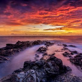 burn the sky by Didik Putradi - Landscapes Sunsets & Sunrises ( clouds, sunset, seascape, beach, burn, rocks )