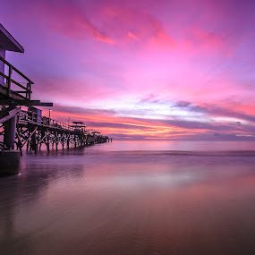 The Long Pier II by Jeremy Jordan - Landscapes Sunsets & Sunrises ( water, sand, us, redington shores, beach, travel, sun, sunset, florida, pier, pink, long exposure, gulf of mexico )