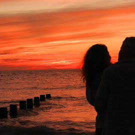 Love at Sunset by Kathy Rose Willis - People Couples ( love, orange, florida, sunset, romantic, silhouettes, couple, gray, romance, black,  )