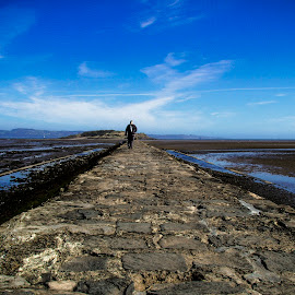 A man walking on the causeway, Edinburgh by Marcelo Fetz - People Street & Candids ( edinburgh; causeway; cramond island )