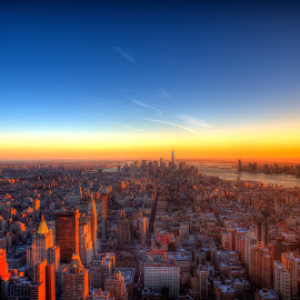 Last minutes of light over Manhattan captured from the 86th floor of the Empire State Building. On the left are the Brooklyn and Manhattan Bridges, in the distance is the Statue of Liberty, right ahead is the new One World Trade Center and all around on the ground are thousands of people just wanting to get home.https://www.etsy.com/listing/184810993/last-moments-of-light?ref=shop_home_active_1 by Alex Shamis - Buildings & Architecture Other Exteriors