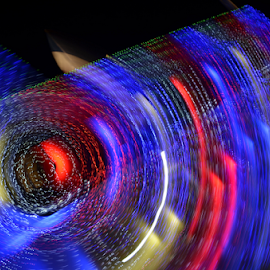 Spinning lights. by Arvind Akki - Abstract Light Painting ( lights, abstract, forms, colours, mood, mood factory, holiday, christmas, hanukkah, red, green, artifical, lighting, colors, Kwanzaa, blue, black, celebrate, tis the season, festive )