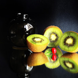 Kiwi slices and Vase by Prasanta Das - Food & Drink Fruits & Vegetables ( vase, kiwi, slices, composition )