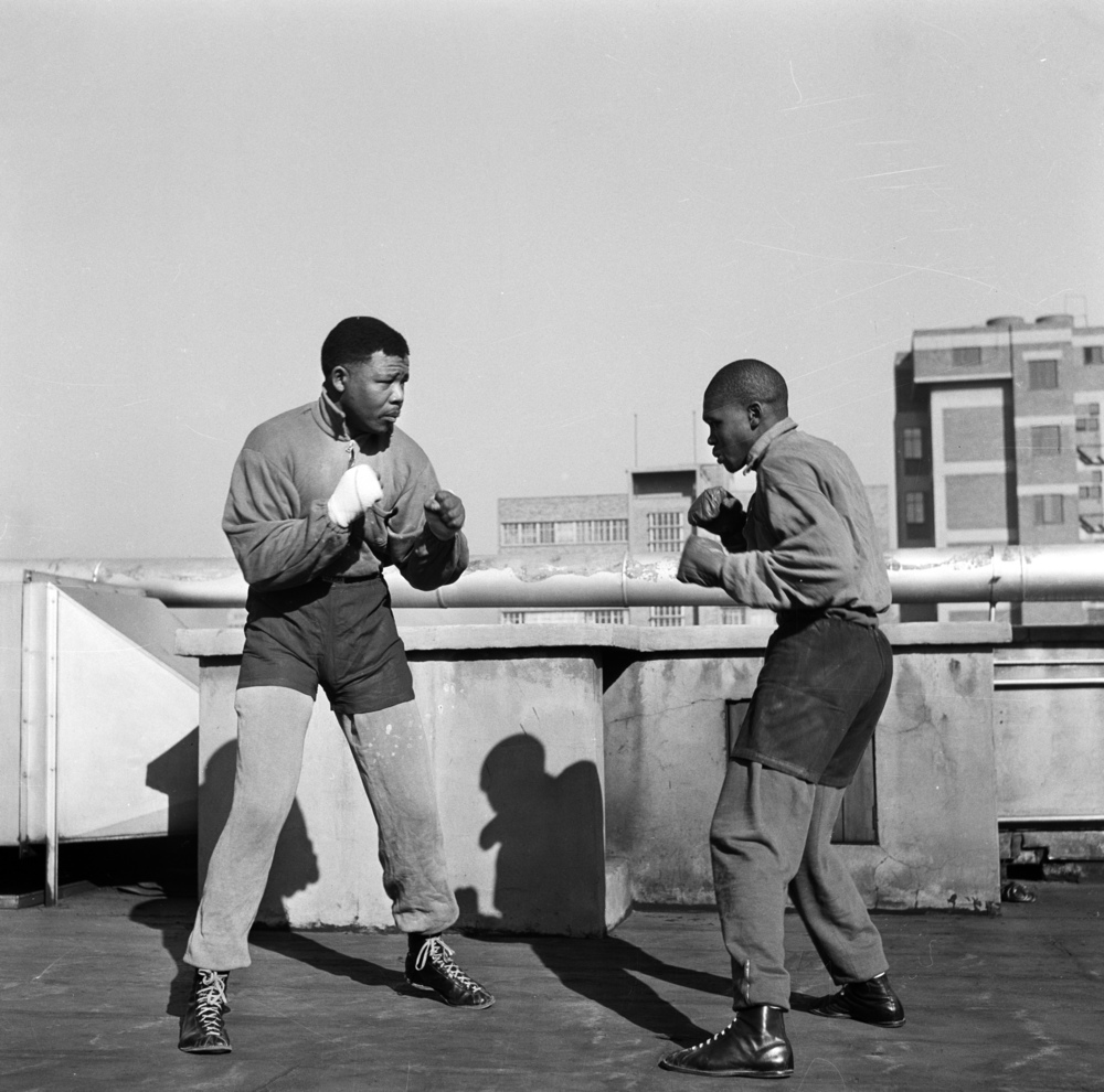 End of Round One - To keep fit, Nelson Mandela, solicitor, was at Jerry Moloi's boxing gym at Orlando every evening. Here he is shadow-sparring with Moloi (right) a professional featherweight.