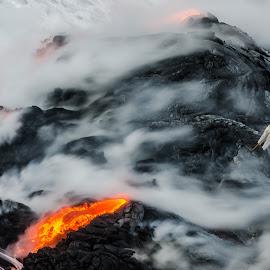 lava entering ocean near meditating man by Matt Mcclenahan - Uncategorized All Uncategorized ( kiluea, waves, rock, ocean, hippie, big island of hawaii, nature, spiritual, lava, vapor, fearless, meditation, long exposure, wet, surf, yoga, hawaii, pele, steam )