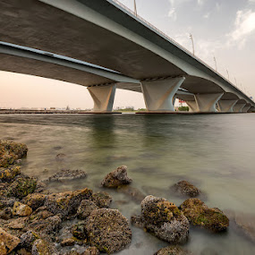 Al Garhoud Bridge by Andrew Madali - Buildings & Architecture Bridges & Suspended Structures ( water, al garhoud, sunset, bridge, rocks )