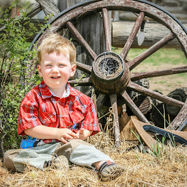 Farm boy by Angelica Glen - Novices Only Portraits & People ( farm, wheel, hay, wagon, boy, hat )