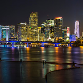 Miami at Night by Bill Kuhn - City,  Street & Park  Skylines ( water, skyline, reflection, building, watson island park, american airlines arena, bayfront park, miami, muesum park, cityscape, freedom tower, bridsge, city, night, long exposure, downtown )