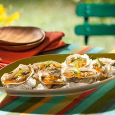 Fire Roasted Low-County Oysters with Tarragon and Red Hot Sauce Butter