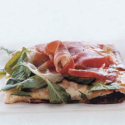 Pizza with Fontina, Prosciutto, and Arugula