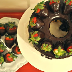 Angel Food Cake covered w/ Chocolate Ganache & w/ Chocolate Covered Strawberries