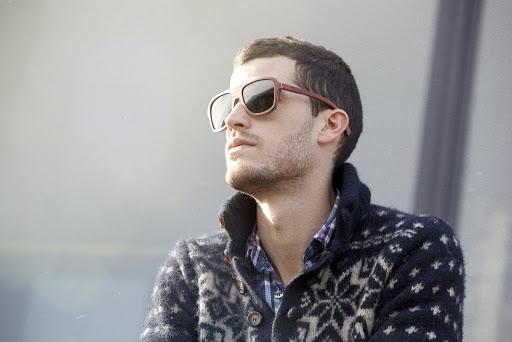 Model wearing wooden sunglasses