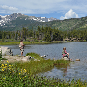 Rocky Mountain Fishing by Del Candler - Sports & Fitness Other Sports ( wildflowers, mountains, sprague lake, woman, lake, rocky mountain national park, fishing, man, , relax, tranquil, relaxing, tranquility )