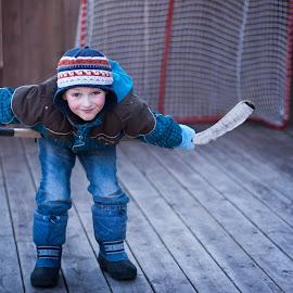 Face off by Jennifer Bacon - Babies & Children Children Candids ( hockey, winter, blue, candid, boy, hat )