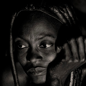 Contemplation by Gene Myers - Black & White Portraits & People ( black and white, woman, himba tribe, bracletts, africa, high contrast, portrait, gene myers, namibia, , Travel, People, Lifestyle, Culture )