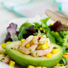 Avocado Stuffed with Spicy Shrimp Over Spring Greens