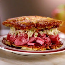 Latke Corned Beef Sandwich with Apple and Sour Cream Slaw