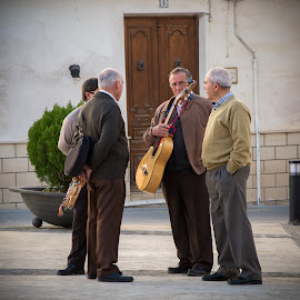 Getting ready to strum in the Spare one Sunday by Chantal Reed - People Musicians & Entertainers ( musicians, old men, spaniards, andalucia, guitar, spain, velez rubio )