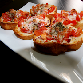 by Dipali S - Food & Drink Plated Food ( plated, bruschetta, mozarella, cuisine, cheesy, food, mozzarella, itallian, basil, tomatoes )