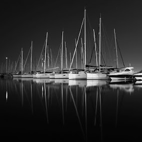 the white of the night by Marc-Antoine Kikano - Transportation Boats ( port, mirror, reflection, yachting, sailing, sea, night, marina, sailboat )