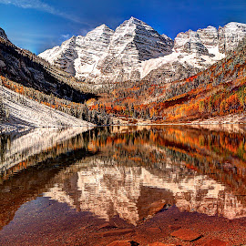 Maroon Bells Lake by John Larson - Landscapes Mountains & Hills ( water, mountains, blue sky, fall, snow, reflections, lake, rocks )