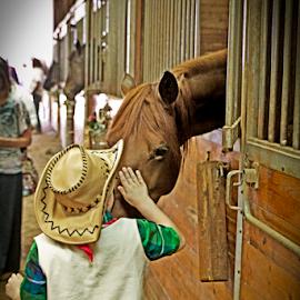 A Kiss by Susan Farris - Babies & Children Children Candids ( kiss, cowboy, stall, horse, stable, boy, hat,  )