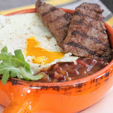 Grilled Breakfast Steak Over Fried Egg and Beans