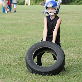 Youth football practice  by Jessica Williams Bender - Sports & Fitness American and Canadian football ( youth football, practice, youth football practice, helmet, tire, workout )