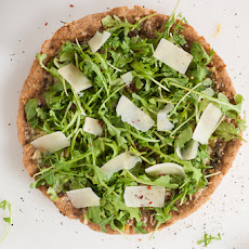Whole Wheat Pesto Pizza with Fresh Arugula and Parmesan